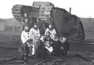 Performers in Front of a Tank